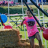 TIM JEAN/Staff photo<br /> <br /> Mia Contarino looks to avoid being hit as she runs through Dave's Danger Pit during the fourth annual Salem Scramble at Salem High School.   9/28/19