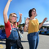 CARL RUSSO/Staff photo. Adriana Byrne, a junior at Whittier Tech high school and Bella Houde, a junior at Haverhill high, both 16, dance to the music of the rock group, The Life of The Party as they perform on stage. Team Haverhill's River Ruckus 2019 was held Saturday in downtown Haverhill on Washington Street. 9/21/2019