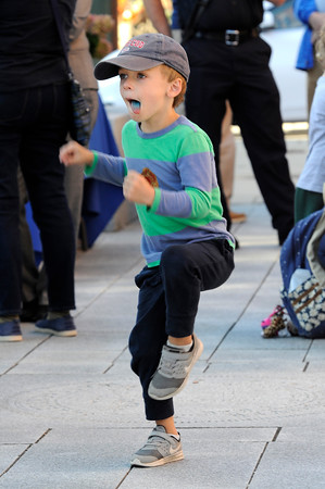 TIM JEAN/Staff photo<br /> <br /> Rory Hughes, 4, dancers to the music during community gathering on the anniversary of the Sept. 13, 2018 gas disaster outside the Old Town Hall in Andover.  9/13/19