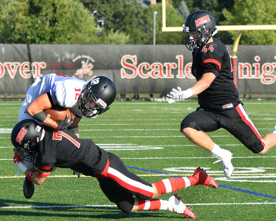 CARL RUSSO/Staff photo. ANDOVERS' MAGAZINE:  North Andover captain, Shaun Nichols makes the tackle on Marblehead's A J Russo as his teammate Cam Watson leaps in to assist. Marblehead defeated North Andover 25-20 in Friday football action. 9/13/2019