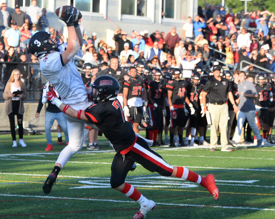 CARL RUSSO/Staff photo. North Andover captain, Shaun Nichols is unable to stop Marblehead's Sean McCarthy from making the touchdown catch that gave them the lead and eventually the win. Marblehead defeated North Andover 25-20 in Friday football action. 9/12/2019