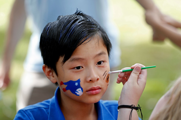 MIKE SPRINGER/Staff photo<br /> Eight-year-old Aidan Lee of North Andover has his face painted Sunday during the St. Michael's Church 150th anniversary picnic on the North Andover Town Common. The event included games, food and live music.<br /> 9/29/2019