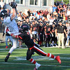 CARL RUSSO/Staff photo. ANDOVERS' MAGAZINE:  North Andover captain, Shaun Nichols is unable to stop Marblehead's Sean McCarthy from making the touchdown catch that gave them the lead and eventually the win. Marblehead defeated North Andover 25-20 in Friday football action. 9/13/2019