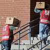 TIM JEAN/Staff photo<br /> <br /> Red Cross workers carry supplies into the shelter at the Arlington School on Friday morning after a reported major gas leak caused a lockdown and evacuation of the South Lawrence.   9/27/19