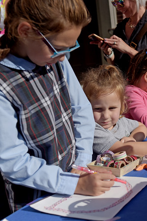 TIM JEAN/Staff photo<br /> <br /> Delia Forina, 9, and her sister Georgia, 4, create colorful art at the Kidcasso Art Studio station, during community gathering on the anniversary of the Sept. 13, 2018 gas disaster outside the Old Town Hall in Andover.  9/13/19