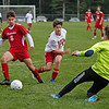 MIKE SPRINGER/Staff photo<br /> Pinkerton's Giovanne Iob, left, draws Spaulding goaltender Cam Molinaro out of the net as Molinaro's teammate Sawyer Fogg, center, looks on during varsity soccer action Thursday in Derry. Molinaro was injured on the play.<br /> 9/12/2019