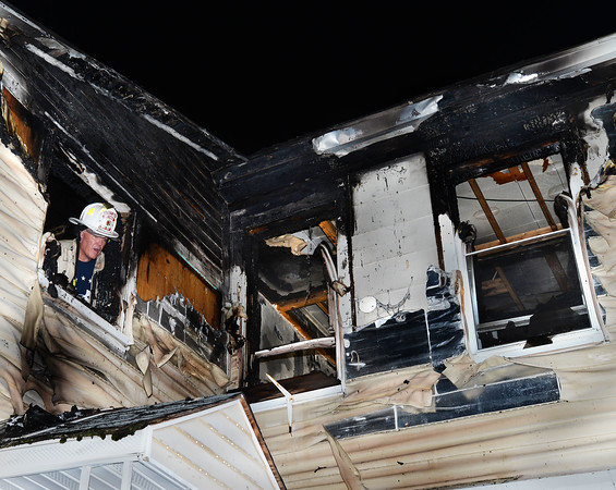 CARL RUSSO/Staff photo. Methuen deputy fire chief, Scott Sullivan  investigates the fire on the second floor, rear of the house. Quick action by the Methuen fire dept. prevented a single alarm fire from destroying a two family home on 12-14 Carlton Street Thursday night. <br /> <br /> Firefighters battled the fire from inside in the rear of the second floor, which had the most interior damage, allowing them to save the structure. <br /> <br /> Residents were out of the building as firefighters arrived, although three were taken to the hospital for minor injuries and evaluation.  9/19/2019