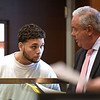RYAN HUTTON/ Staff photo <br /> Brian Grande, 18, speaks to his lawyer during his arraignment in Haverhill District Court on Monday morning after a shooting on Jackson Street in Haverhill on Sunday in which no one was injured but two homes were struck by bullets.