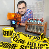 CARL RUSSO/Staff photo. Michael Mankarios of Haverhill looks at items found in a Forensic Science class. <br /> <br /> Michael Mankarios, who immigrated to the United States from Egypt six years ago with only $200 to his name, recently graduated from Northern Essex Community College with an associate's degree in criminal justice. He won a full boat scholarship to UMass Boston. 9/12/2019