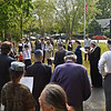 RYAN HUTTON/ Staff photo <br /> The members of Tempel Emanu-el sing together after they tossed bread into Round Pond following Rosh Hashanah service on Monday morning, an act that symbolizes casting away sins for the Jewish New Year.
