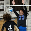 CARL RUSSO/Staff photo Methuen's Rachel Batista attempts to block the spike by Haverhill's Jadalee Burdier. Haverhill high defeated Methuen 3-0 in volleyball action at Haverhill high school Wednesday afternoon. 9/11/2019