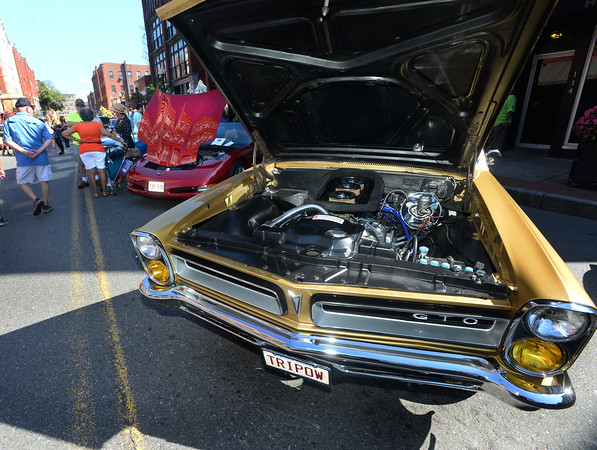 CARL RUSSO/Staff photo.  Classic car show on Washington Street featuring a Pontiac GTO. <br /> <br /> Team Haverhill's River Ruckus 2019 was held Saturday in downtown Haverhill on Washington Street. 9/21/2019