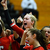 CARL RUSSO/Staff photo North Andover's Emily Grant celebrated with her teammates. North Andover defeated Dracut high in three straight games of volleyball action Monday afternoon. 9/30/2019