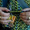 """MIKE SPRINGER/Staff photo<br /> Haverhill High School teacher and breast cancer survivor Nancy Burke keeps a wristband from last February's """"Blackout For Cancer"""" event, at which she was honored, around her keychain as a memento.<br /> 9/18/2019"""