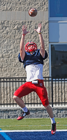 MIKE SPRINGER/Staff photo<br /> Central Catholic's Nate Hebert catches a pass during practice Thursday.<br /> 9/18/2019