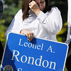 TIM JEAN/Staff photo<br /> <br /> Rosaly Rondon the mother of Leonel Rondon, wipes away tears after the family unveiled the sign for him during a dedication ceremony for Rondon Square. The square is on the corner of Chestnut and Jackson St., Lawrence not far from where Leonel Rondon had lived. Rondon was the single fatality in the Sept. 13, 2018 gas disaster.  9/13/19