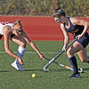 MIKE SPRINGER/Staff photo<br /> Andover's Emma Reilly, right, tries to move the ball past Michaela Downer of North Andover during varsity field hockey play Wednesday at North Andover.<br /> 9/25/2019