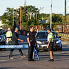 RYAN HUTTON/ Staff photo <br /> Lawrence Police Chief Roy Vasque speaks to one of his officers at the intersection of Merrimack Street and Broadway ion South Lawrence on Friday after a reported major gas leak caused a lockdown and evacuation of the area.