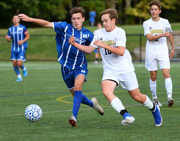 CARL RUSSO/Staff photo. Methuen's Nassiam Bendimerad. left and Haverhill's Jaden Shaut battle, for the ball. Haverhill defeated Methuen 1-0 in boys soccer action Tuesday afternoon. 9/24/2019