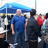 CARL RUSSO/Staff photo Brian Bald, third from the right, of Atkinson Street waits in line with dozens of people to file a claim. Columbia Gas provided a claims center in the parking lot of St. Patrick's Church on Monday.  The center was organized to help the South Lawrence residents and business owners impacted by Friday's gas leak. 9/30/2019