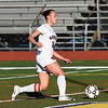 RYAN HUTTON/ Staff photo <br /> Central Catholic's Kaleigh Lane drives the ball downfield during Thursday's game at Andover High School.