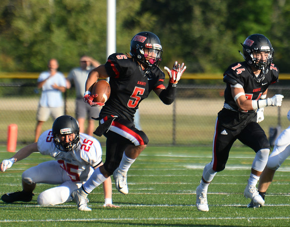 CARL RUSSO/Staff photo. North Andover captain, Freddy Gabin begins his kick-off return for a 78 yard touchdown. Marblehead defeated North Andover 25-20 in Friday football action. 9/12/2019