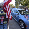 RYAN HUTTON/ Staff photo <br /> Eric Lekberg, of Chelmsford, stands with an American flag as the remains of Methuen native and Korean War veteran Eileen Robichaud arrive at Elmwood Cemetery for burial.