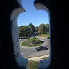 TIM JEAN/Staff photo<br /> <br /> Looking out through the clock face from the bell tower of the North Andover Meeting House toward the common and the traffic circle.  9/26/19