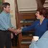 TIM JEAN/Staff photo<br /> <br /> Democratic presidential candidate Joe Sestak, left, shakes hands with Carla Billingham, of Salem, during a during a campaign stop at the home of Salem Democratic Town Chair Janet Breslin-Smith and her husband Jim Smith.  9/12/19