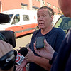 TIM JEAN/Staff photo<br /> <br /> Lawrence resident Lori Martin speaks with the media outside a Red Cross shelter at the Arlington School on Friday morning after a reported major gas leak caused a lockdown and evacuation of the South Lawrence.   9/27/19