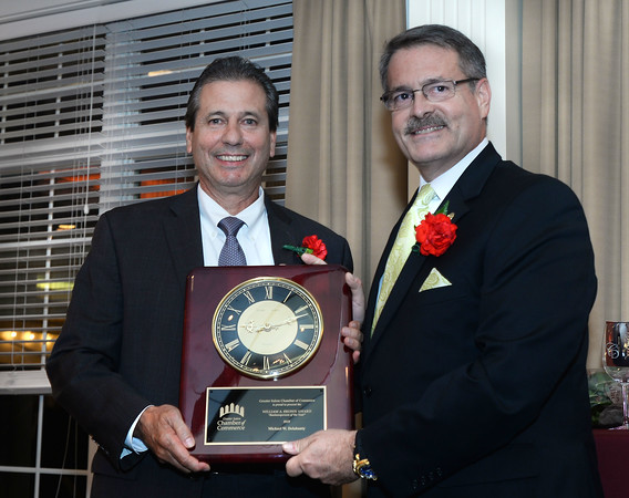 CARL RUSSO/staff photo. Michael Delahanty, Salem School District Administrator, left, is presented the 2019 William A. Brown Business Person of the Year Award by the 2018 recipient, Peter Rayno at the Greater Salem Chamber of Commerce 31st. Annual Dinner and Awards Ceremony. The event was held at the Brookstone Event Center in Derry Wednesday night.<br />  <br /> Delahanty is winning the 2019 William A. Brown Business person of the Year Award. <br /> Macoul is winning the 2019 Volunteer of the Year. Sweeney-Glickel is winning the 2019 Chairman's Award. 9/25/2019