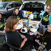 CARL RUSSO/Staff photo The Allan family of Windham:  Toby and Tara, their daughter Nadya, 11, left and her friends Gwen Vincent, right and Kate Ryan, 11 have a tail gate party before going to the 9th Annual Windham high Jaguar Blackout Cancer Football Game Friday night on September 27. <br /> <br /> Windham-grown Project Blackout kicks off a series of events around the town to generate awareness of pediatric cancer and raise funds to support research efforts and care for the children and families currently battling pediatric cancer in Windham. Students performed at the football game halftime show dedicated to families who have been helped by the project. 9/27/2019