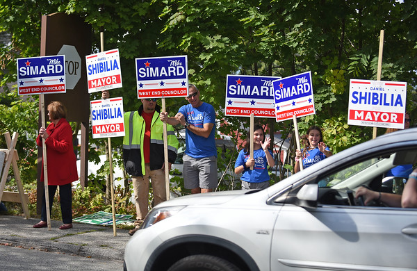 RYAN HUTTON/ Staff photo <br /> Sign holders wave to traffic leaving the polls at Marsh Grammar School during Tuesday's election in Methuen.