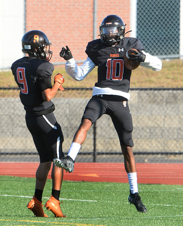 CARL RUSSO/Staff photo. Reggie wide receiver, Alvin Torres, 10 celebrates his second touchdown of the game with teammate Rene Lopes. Greater Lawrence Tech. defeated Northeast high in Friday football action.  9/20/2019