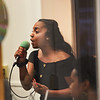 TIM JEAN/Staff photo<br /> <br /> Niema Aviles, 13, of Haverhill, sings a song in the Merrimack Valley Music & Arts Youth Music Showcase during the first annual Art Walk throughout downtown Haverhill.    9/14/19