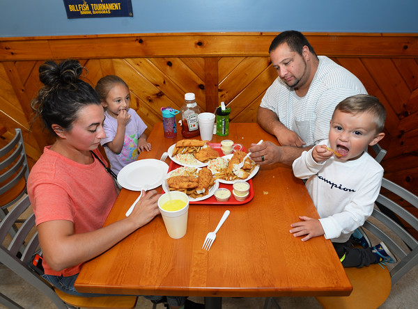 CARL RUSSO/staff photo. READING MAG: The Santos family: A.J. and Miranda of Tewksbury and their children, Benjamin, 2 and Sofia, 5 have dinner.<br /> <br /> The Lobster Claw, a North Reading family owned restaurant since 1976 was Started by Harry Gresek. His sons, Victor Gresek and Luke Gresek continue the family business after Harry's passing. The two brothers took over three years ago. The restaurant is known for its chowders and sauces and fresh seafood. 9/12/2019