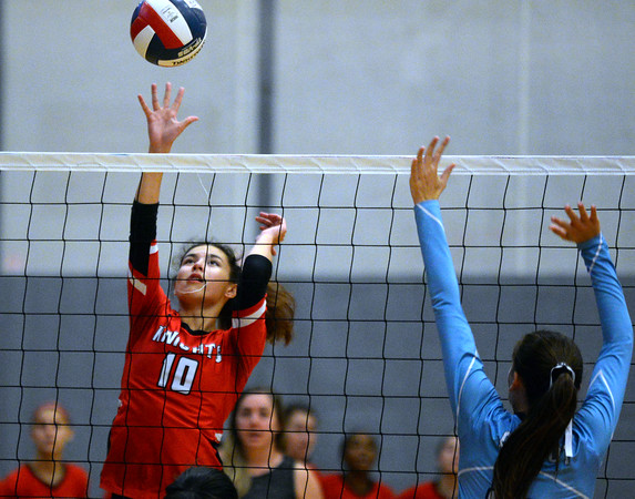 CARL RUSSO/Staff photo North Andover's Ceclia Wong keeps the ball in play. North Andover defeated Dracut high in three straight games of volleyball action Monday afternoon. 9/30/2019