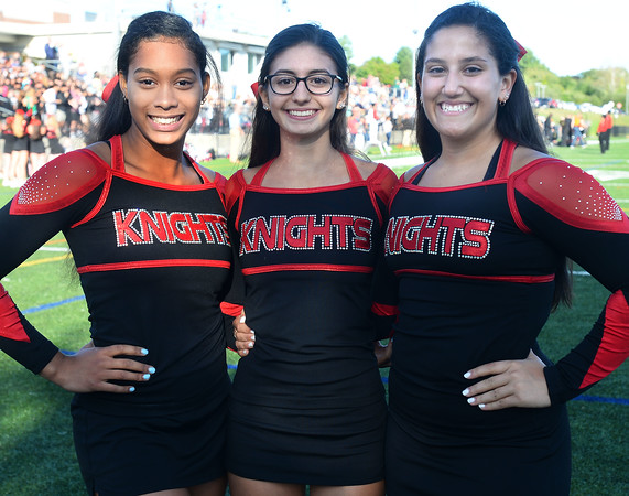 CARL RUSSO/Staff photo. ANDOVERS' MAGAZINE: North Andover high senior football cheerleading captains, from left, Alana Myers, Aryana Reppucci and Ava Marconi.  Marblehead defeated North Andover 25-20 in Friday football action. 9/13/2019