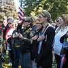 """RYAN HUTTON/ Staff photo <br /> The crowd sings along to """"The Battle Hymn of the Republic""""  at the funeral of Methuen native and Korean War veteran Eileen Robichaud at Elmwood Cemetery on Friday. A call was put out for people to attend her funeral after it was discovered that she had very few living relatives."""