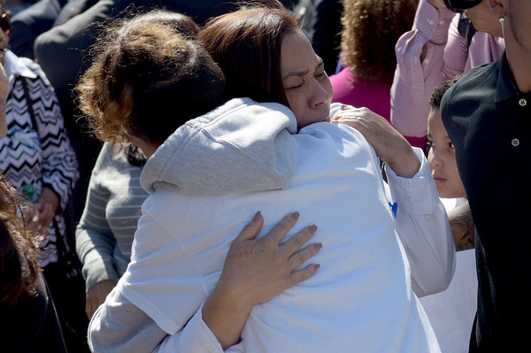TIM JEAN/Staff photo<br /> <br /> Rosaly Rondon the mother of Leonel Rondon, hugs one of  his friends during a dedication ceremony for Rondon Square.  9/13/19