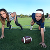 CARL RUSSO/Staff photo. Jen Welter works with Rachel McDevitt, 11, a 6th. grader at the North Andover Middle School, teaching her the fundamentals of football and a three-point stance (seen here).<br /> <br />  Jen is a former NFL assistant coach who has made it her mission to promote the sport for girls, teaching fundamentals so girls can play and be successful in flag football. As a coach, Jen wants more girls in the sport. 9/19/2019