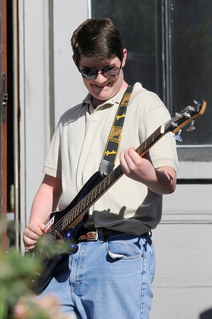 """TIM JEAN/Staff photo<br /> <br /> Chris Shepley on the bass guitar performs with the student band """"Live Wire"""" during community gathering on the anniversary of the Sept. 13, 2018 gas disaster outside the Old Town Hall in Andover.  9/13/19"""