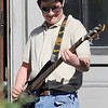 "TIM JEAN/Staff photo<br /> <br /> Chris Shepley on the bass guitar performs with the student band ""Live Wire"" during community gathering on the anniversary of the Sept. 13, 2018 gas disaster outside the Old Town Hall in Andover.  9/13/19"