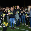 CARL RUSSO/Staff photo Windham students form two lines as they greet cancer survivors and their families with flowers while they walk onto field. The 9th Annual Windham high Jaguar Blackout Cancer Football Game was held Friday night on September 27. <br /> <br /> Windham grown Project Blackout kicks off a series of events around the town to generate awareness of pediatric cancer and raise funds to support research efforts and care for the children and families currently battling pediatric cancer in Windham. Students performed at the football game halftime show dedicated to families who have been helped by the project. 9/27/2019