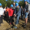 RYAN HUTTON/ Staff photo <br /> Norm Young, Friends of the Moeckel Pond committee member, digs the first shovel full of dirt during the official ground-breaking ceremony to start construction of the new Marston-Finn Conservation Dam off Moeckel Road.