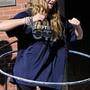 TIM JEAN/Staff photo<br /> <br /> Leah Satlow, 12, of Andover, competes in a hula hoop contest during community gathering on the anniversary of the Sept. 13, 2018 gas disaster outside the Old Town Hall in Andover.  9/13/19