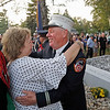 MIKE SPRINGER/Staff photo<br /> Retired New York City firefighter Tom Lonegan receives a celebratory embrace from Cindi Woodbury, member of the Salem Won't Forget Committee, at the conclusion of a ceremony Wednesday dedicating the 9/11 Monument  on the Salem Town Common.<br /> 9/10/2019