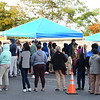 CARL RUSSO/Staff photo People wait in line to file a claim. Columbia Gas provided a claims center in the parking lot of St. Patrick's Church on Monday.  The center was organized to help the South Lawrence residents and business owners impacted by Friday's gas leak. 9/30/2019
