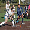 MIKE SPRINGER/Staff photo<br /> Haverhill's Sydney Keyes takes a penalty corner shot as Dungdara Kim of Lawrence defends during varsity field hockey play at Haverhill<br /> 9/18/2019
