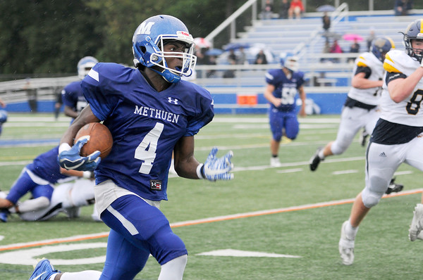 TIM JEAN/Staff photo<br /> <br /> Methuen running back Kareem Coleman runs for a touchdown during a football game against  Malden Catholic. Methuen won 47-14.  9/14/19